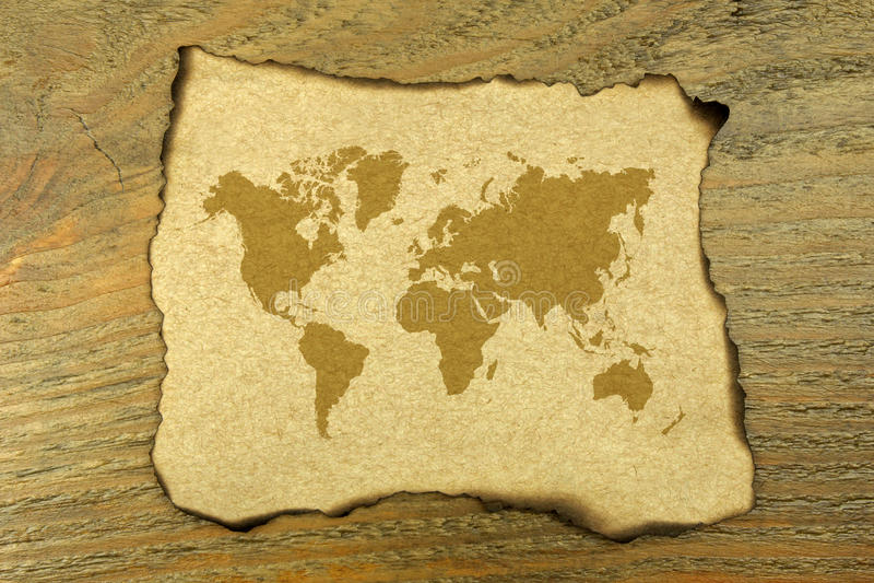 Världskarta på bränt papper arkivbild