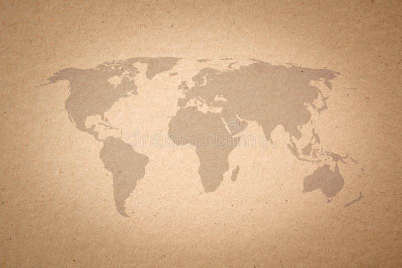 Världskarta på pappers- texturbakgrund royaltyfri foto