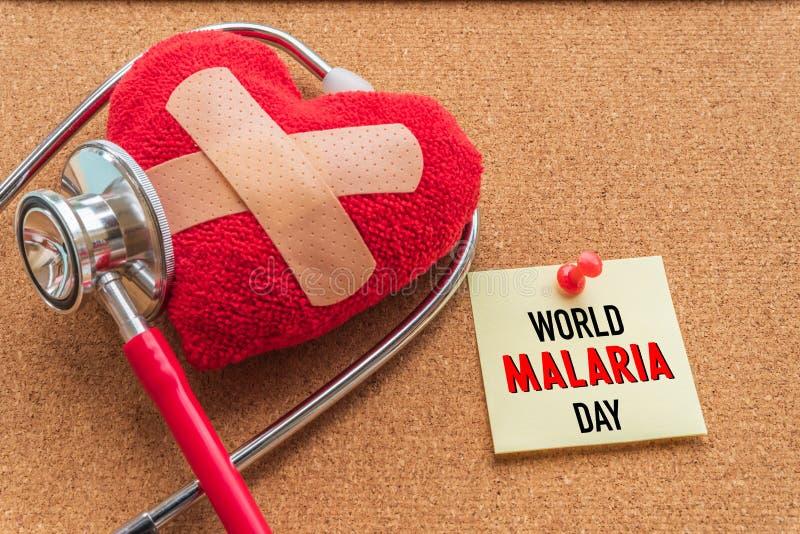 VärldsMALARIAdag April 25, sjukvård- och läkarundersökningbegrepp arkivbilder