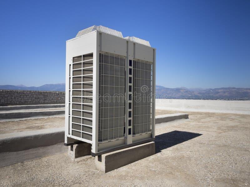 Värma och betingande inverterare för luft arkivfoton