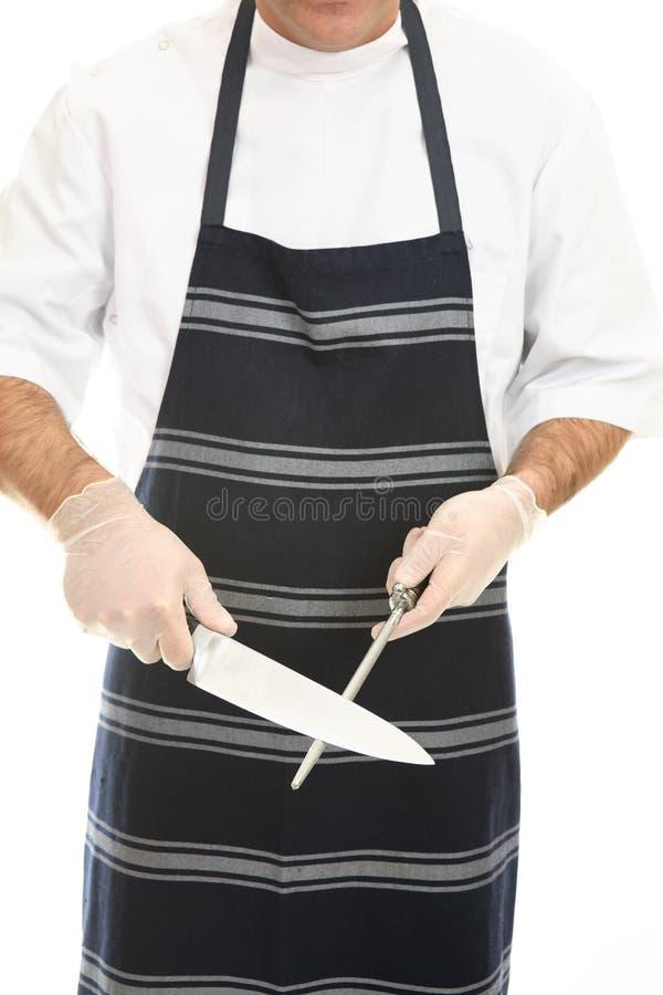 vässa för slaktarekniv arkivbild