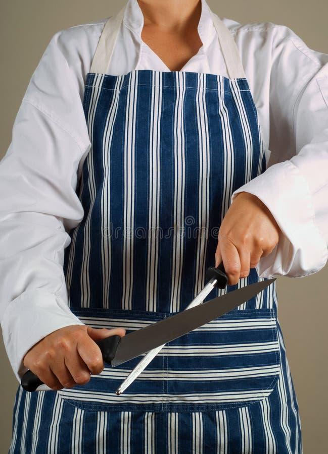 vässa kvinna för kockkniv arkivfoto