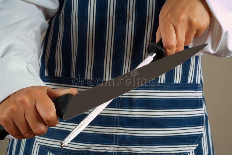 vässa kvinna för kockkniv royaltyfria foton