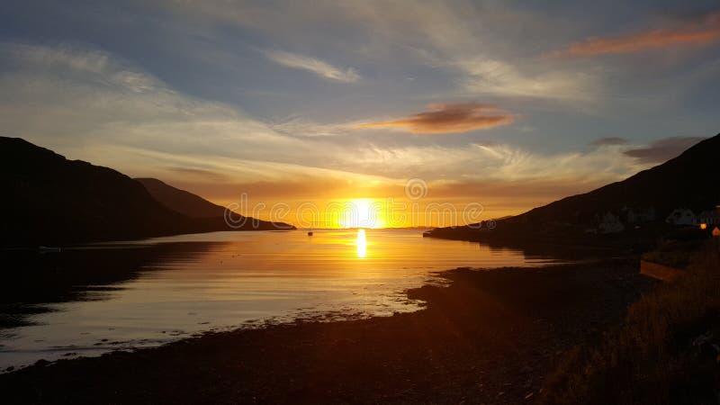 Västra Tarbert solnedgång royaltyfria bilder