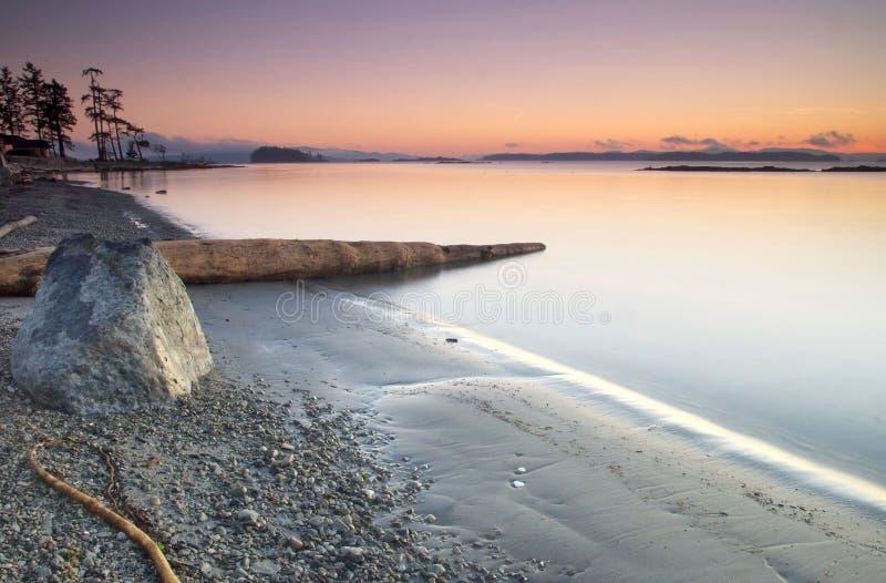 västra vinter för kustsoluppgång royaltyfria foton