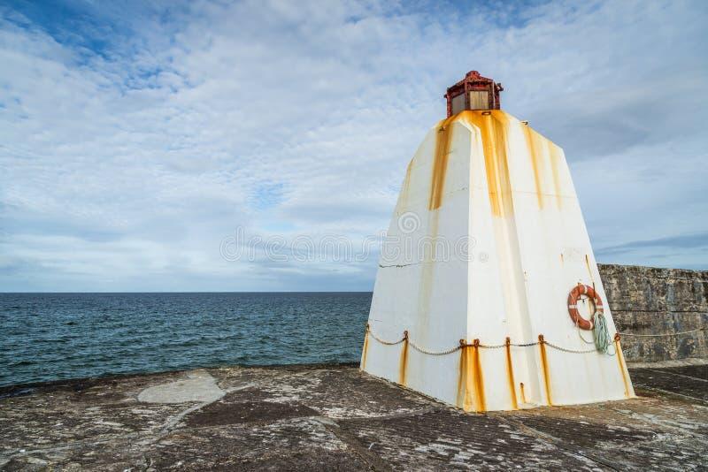 Vågbrytare i Burghead, skotsk Skotska högländerna arkivfoton