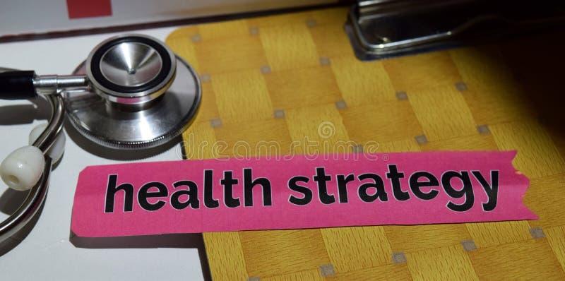 Vård- strategi på tryckpapperet med läkarundersökning- och sjukvårdbegrepp royaltyfri foto