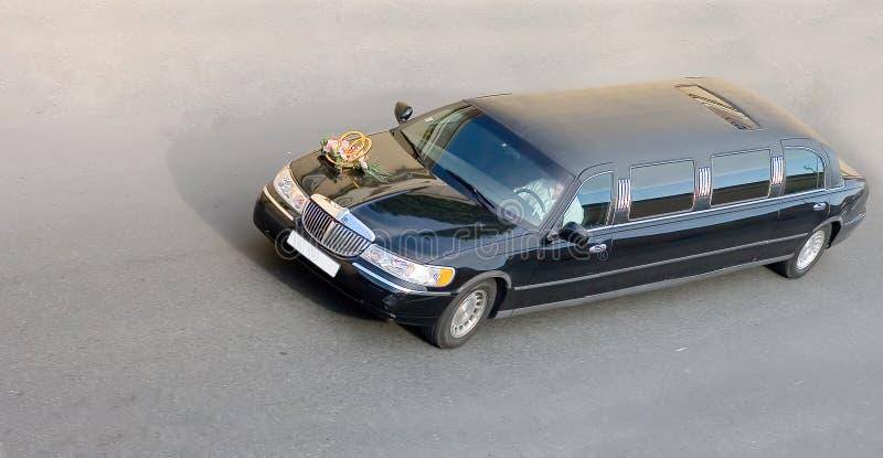 Véhicule noir de limousine de mariage de   photographie stock libre de droits