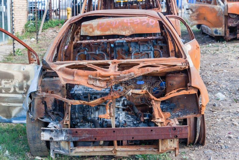 Véhicules détruits par feu photographie stock libre de droits