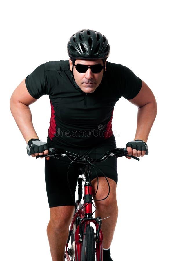 Vélo d'équitation de cycliste photo stock