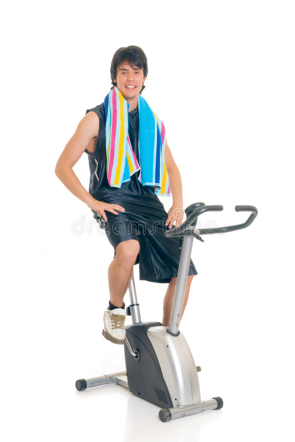 Vélo de forme physique d'adolescent photo stock