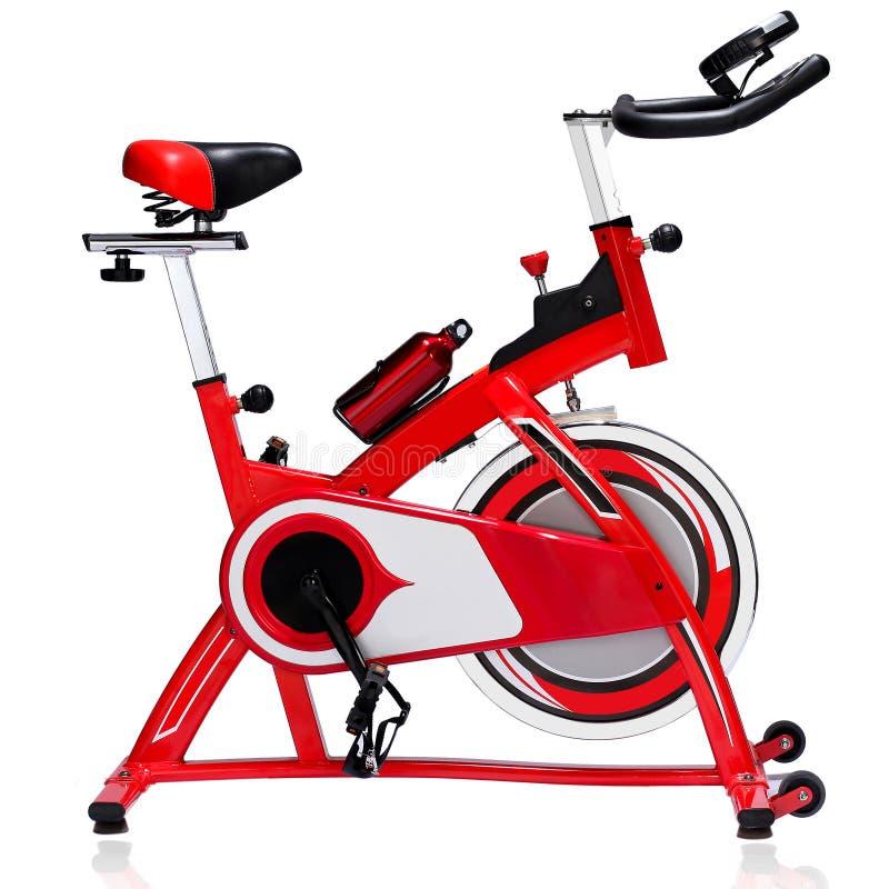 Vélo de rotation rouge photo stock