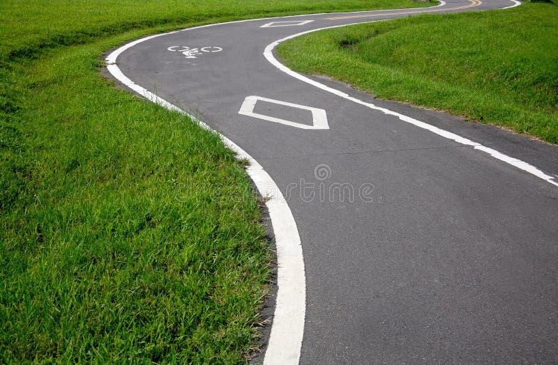 Vélo et la route photographie stock