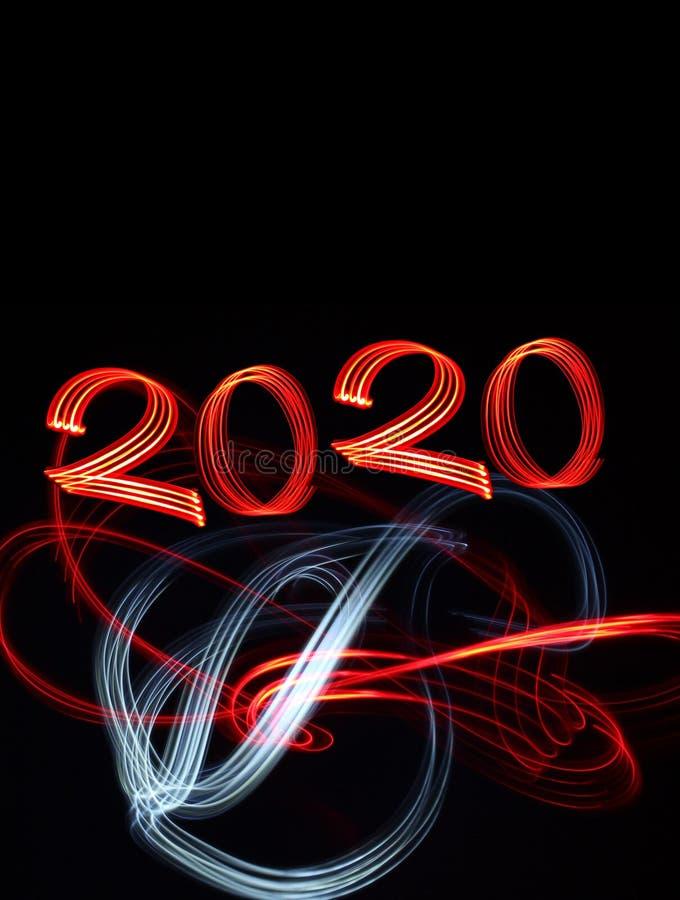 Véspera de Ano Novo 2020 com Fireworks com Luzes Abstratas fotos de stock royalty free