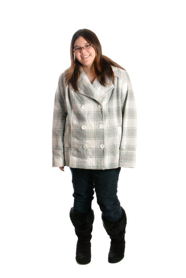 Vêtement s'usant de l'adolescence de sourire de l'hiver photographie stock