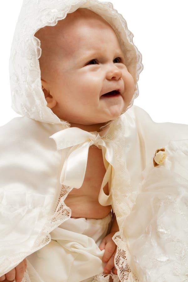 vêtements baptismaux de chéri photo stock