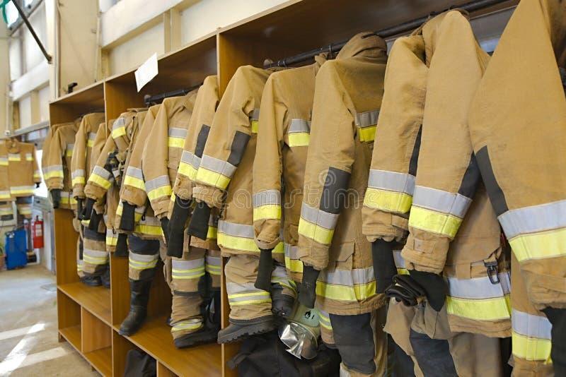 Vêtements de pompier images libres de droits