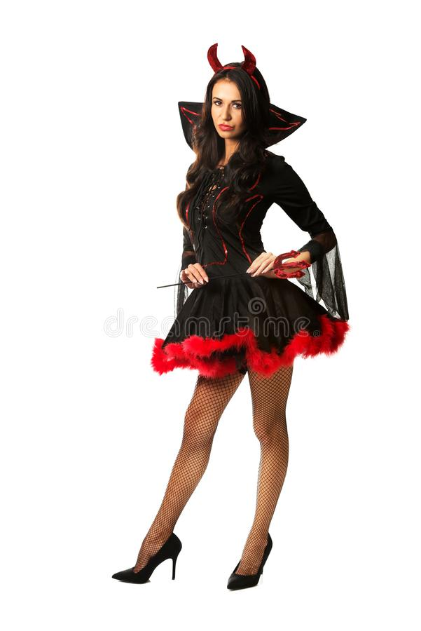 Vêtements de port de diable de femme tenant le trident photos stock