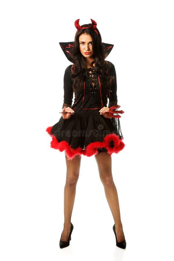 Vêtements de port de diable de femme tenant le trident photos libres de droits