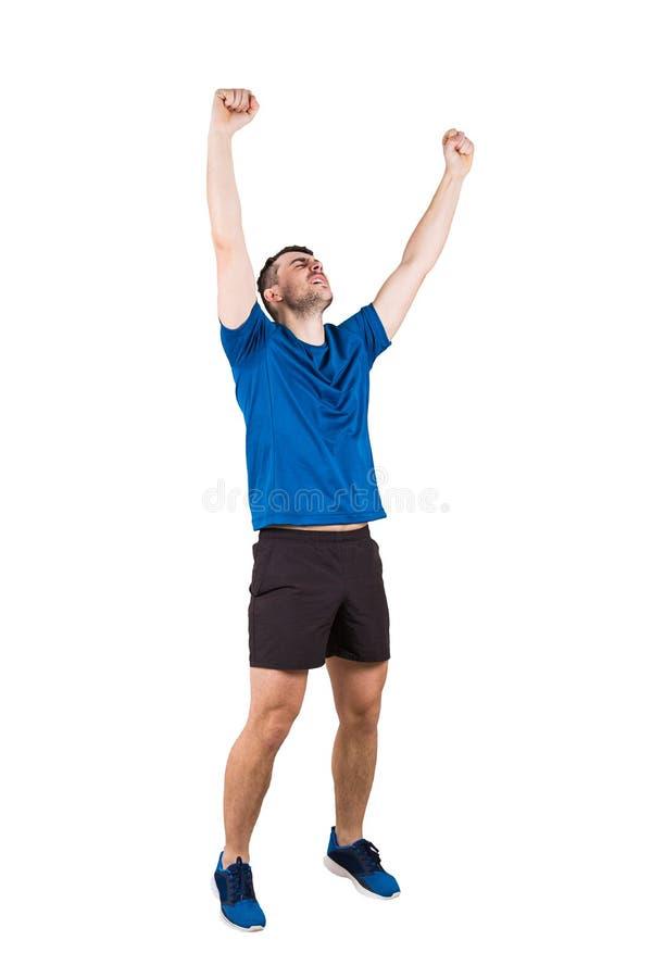 Vêtements de sport de port de type sportif honorer sa victoire d'isolement au-dessus du fond blanc photos stock