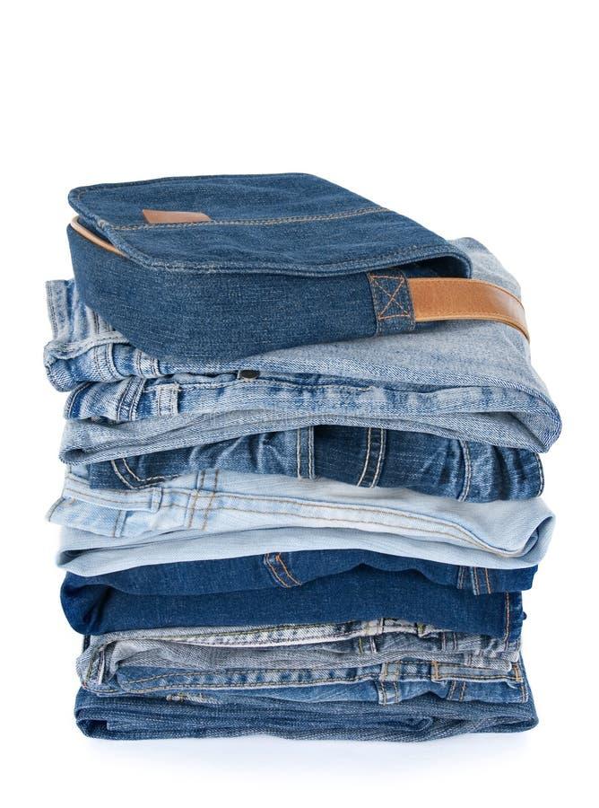 Vêtements et sac bleus de denim photo libre de droits