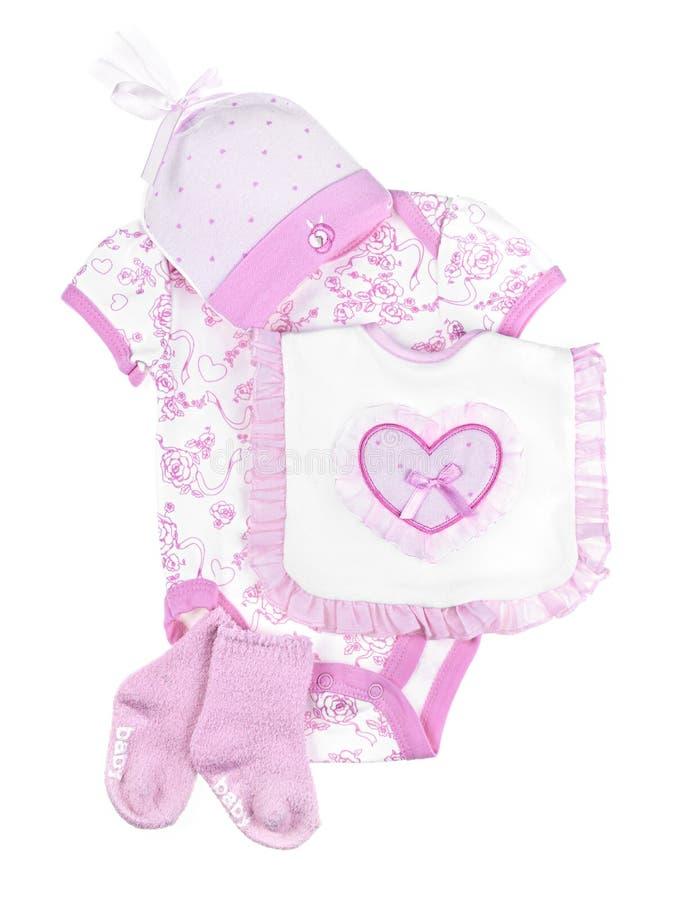 Vêtements roses de chéri pour la fille infantile image libre de droits