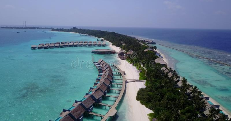 V03539 Aerial flying drone view of Maldives white sandy beach on sunny tropical paradise island with aqua blue sky sea royalty free stock image