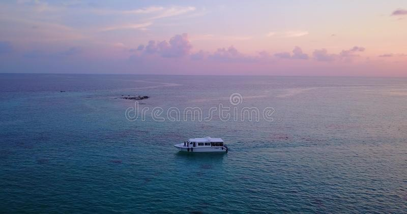 V03036 Aerial flying drone view of Maldives white sandy beach on sunny tropical paradise island with aqua blue sky sea stock photography