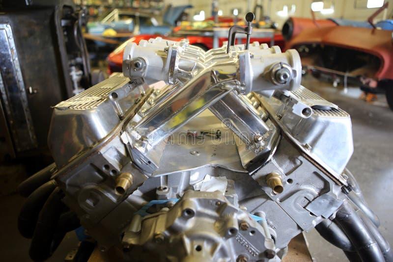 V8 Aluminum racing engine. Inside a automotive garage stock photography