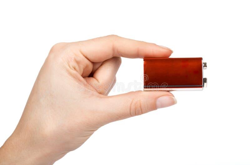 9V batteri, nio volt maktcell i hand bakgrund isolerad white fotografering för bildbyråer