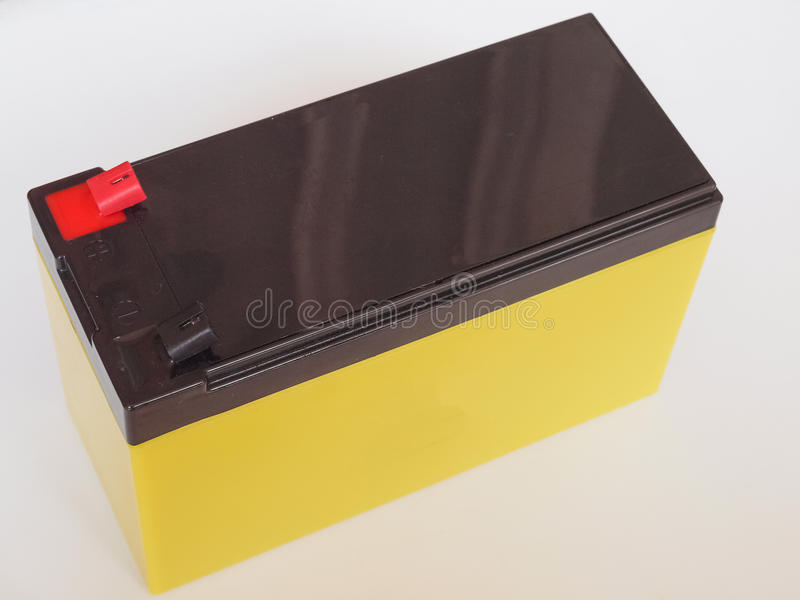 12V Battery. A 12 Volt sealed lead acid backup battery for electronic devices stock photo