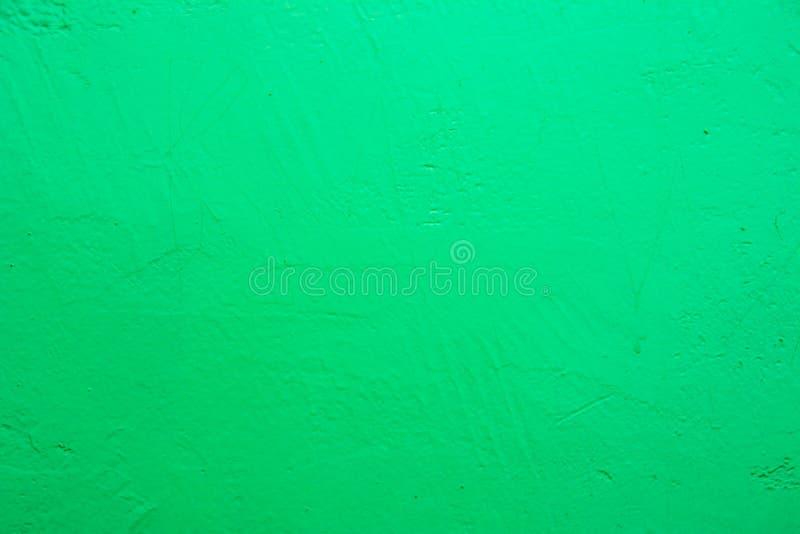 V?gg som m?las i bl?tttextur Sömlös textur av ett ljust blekt - grön betongvägg arkivbild