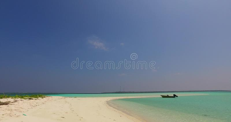 V02004 Maldives beautiful beach background white sandy tropical paradise island with blue sky sea water ocean 4k boat royalty free stock images
