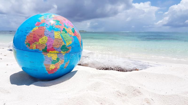 V01297 Maldives beautiful beach background white sandy tropical paradise island with blue sky sea water ocean 4k globe. Maldives beautiful beach background white royalty free stock images