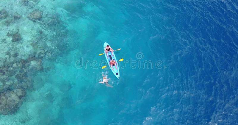 Download V09385 People Enjoying Boats And Watersports With View From Aerial Flying Drone In Clear Aqua Blue Sea Water And Blue Stock Photo - Image of paddleboard, flying: 103547560