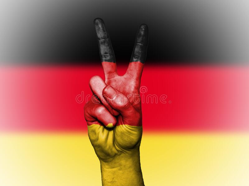V sign and flag of Germany