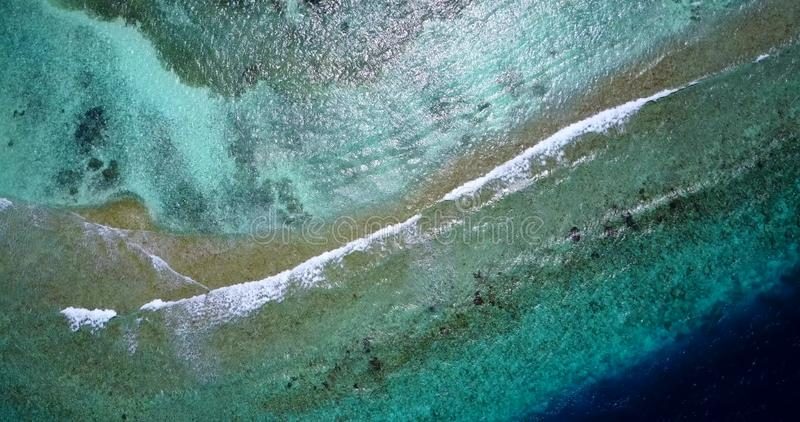 V13236 waves water texture breaking and crashing with drone aerial flying view of aqua blue and green clear sea ocean. Waves water texture breaking and crashing royalty free stock photo