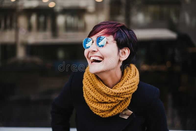 Young beautiful woman wearing sunglasses outdoors. Urban and lifestyle outdoors concept royalty free stock photos