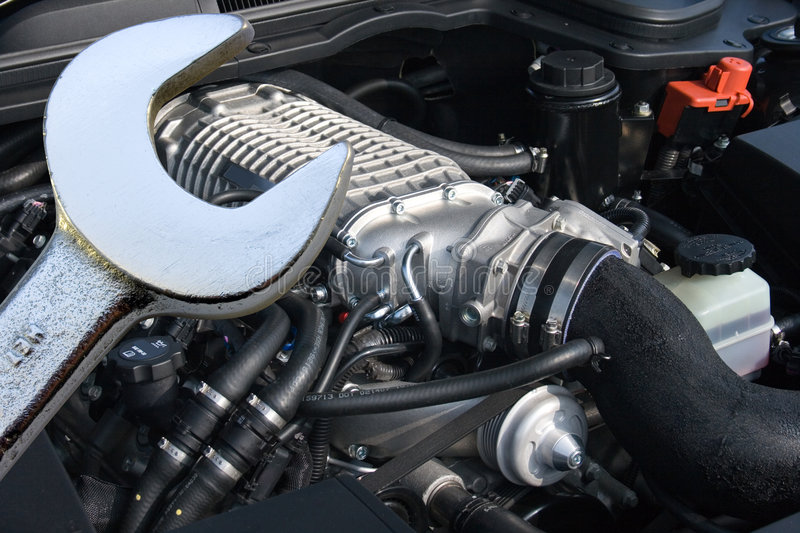 V8 supercharged car engine and spanner