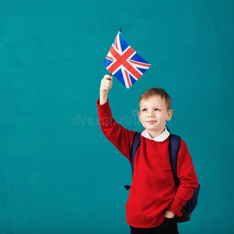 Vacances d'école Royaume-Uni R-U Petit écolier avec le natio image libre de droits