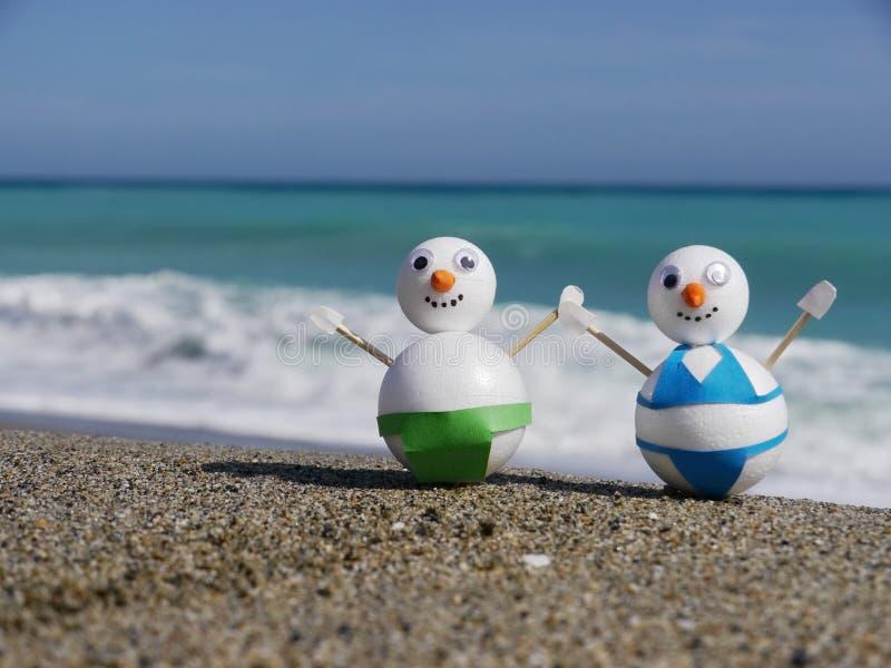 Vacanza della spiaggia del pupazzo di neve fotografie stock libere da diritti