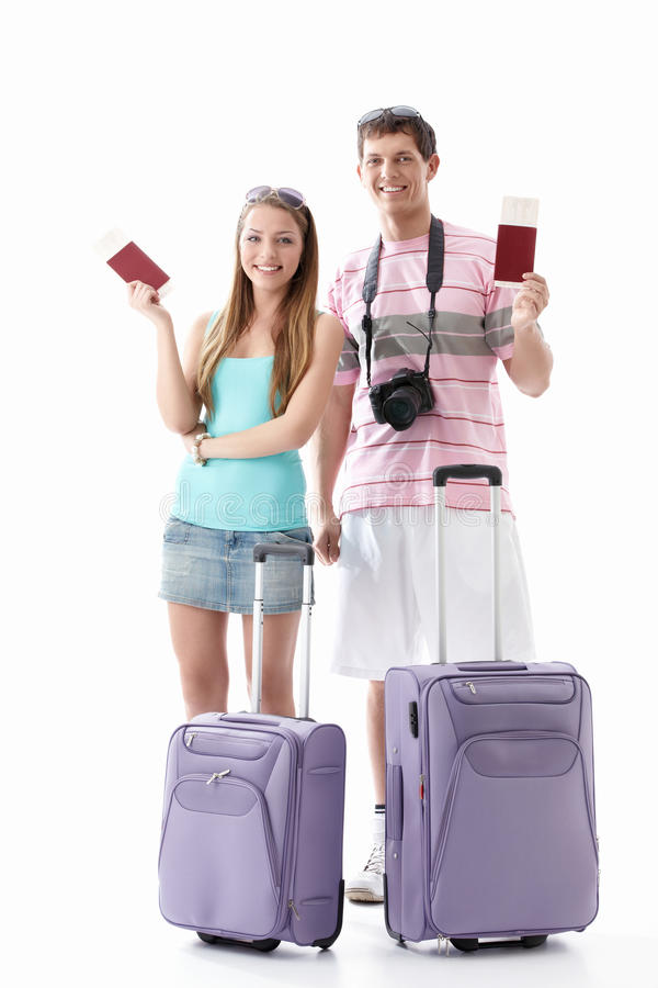 Vacation. Smiling couple with passports and suitcases on a white background stock images