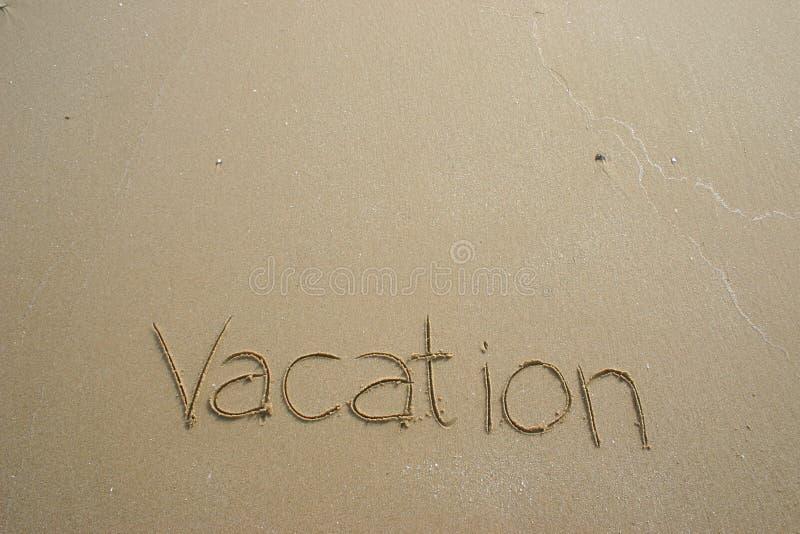 Vacation. Written on the beach stock photos