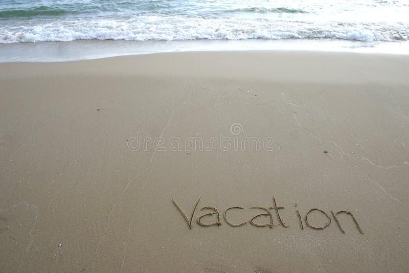 Vacation. Written on the beach stock photo