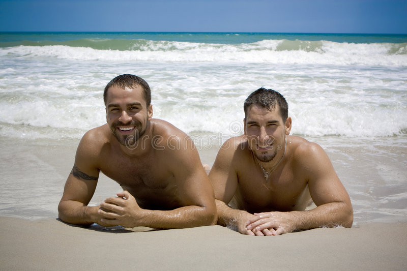 Vacation. Two gay man at the beach stock images