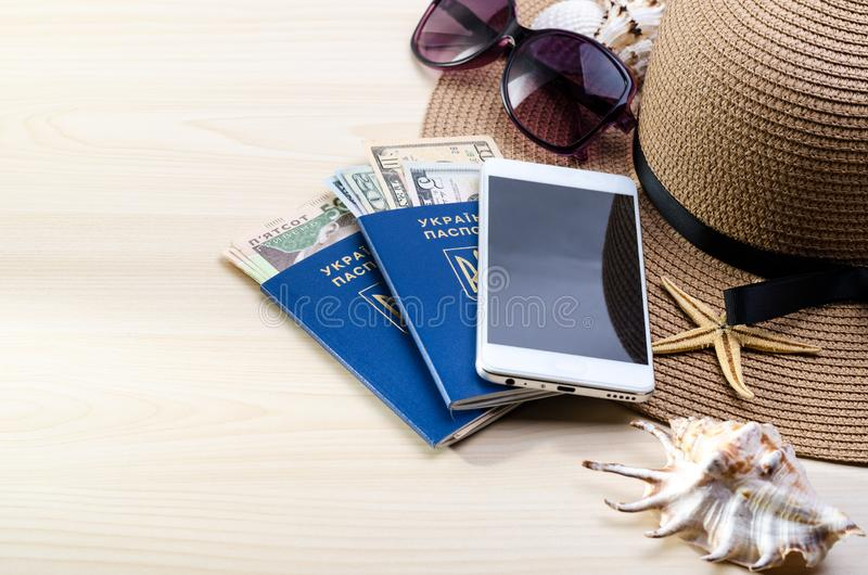 Summer Vacation accessories, documents, ukrainian biometric passports and money. Good for touristic service. Vacation accessories, documents, passports and money stock photography
