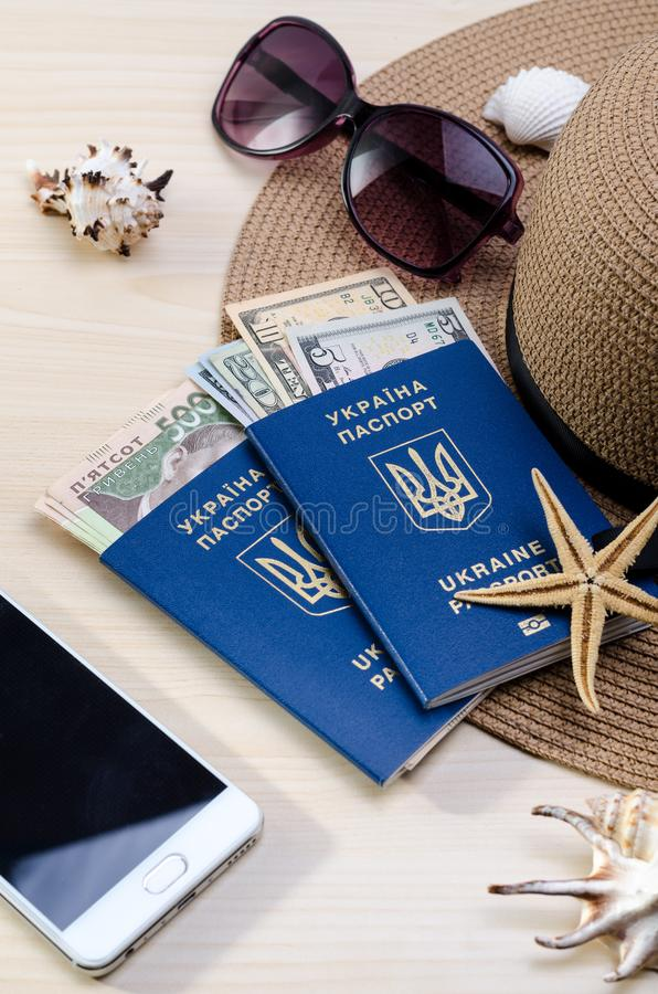 Vacation accessories, documents, ukrainian biometric passports and money. Good for touristic service. Summer Vacation accessories, documents, ukrainian biometric stock photos