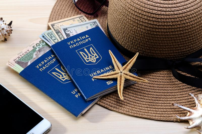 Vacation accessories, documents, ukrainian biometric passports and money. Good for touristic service. Summer Vacation accessories, documents, ukrainian biometric royalty free stock images