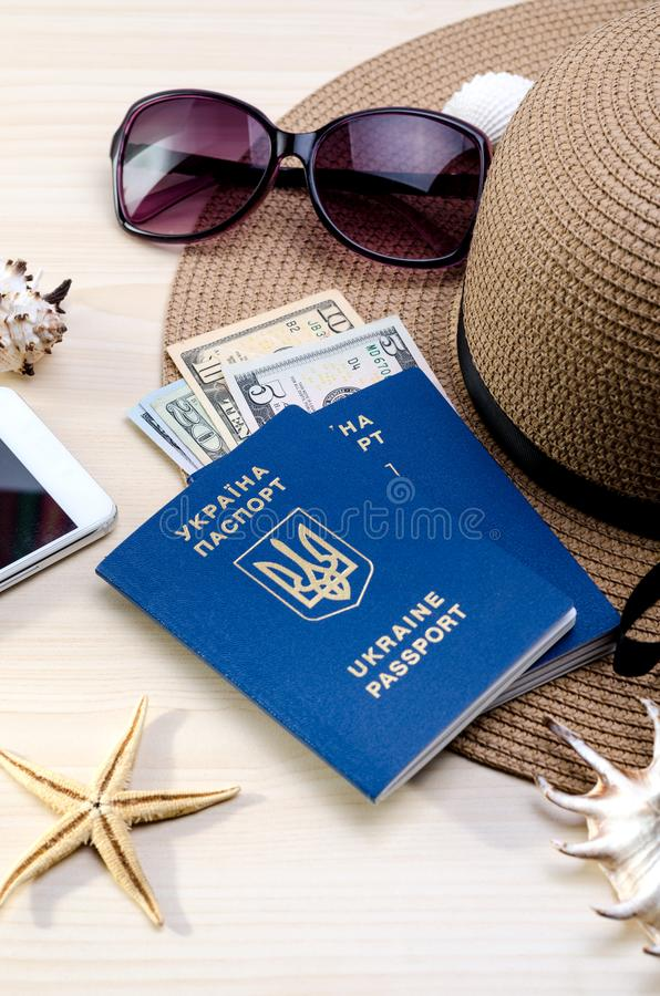 Vacation accessories, documents, ukrainian biometric passports and money. Good for touristic service. Summer Vacation accessories, documents, ukrainian biometric stock images