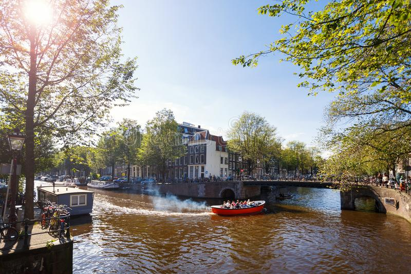 Vacation in Amsterdam in autumn. People travel by boat along the canals of Amsterdam in autumn stock photos